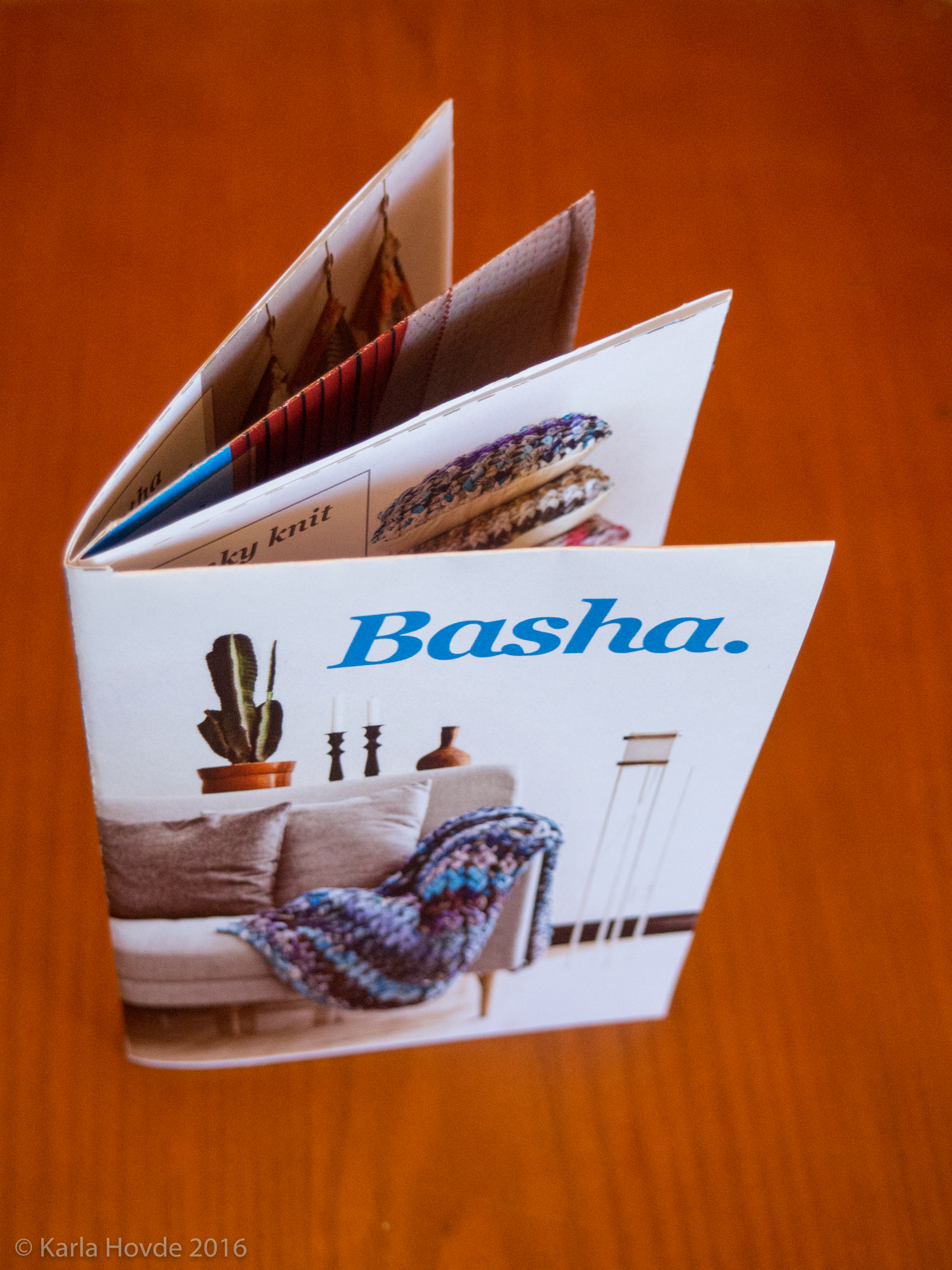 Photo of miniature Basha product catalogue made from one sheet of cleverly folded paper